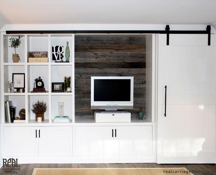 Best 25 barn door over tv ideas on pinterest tv stand for Hidden sliding screen door