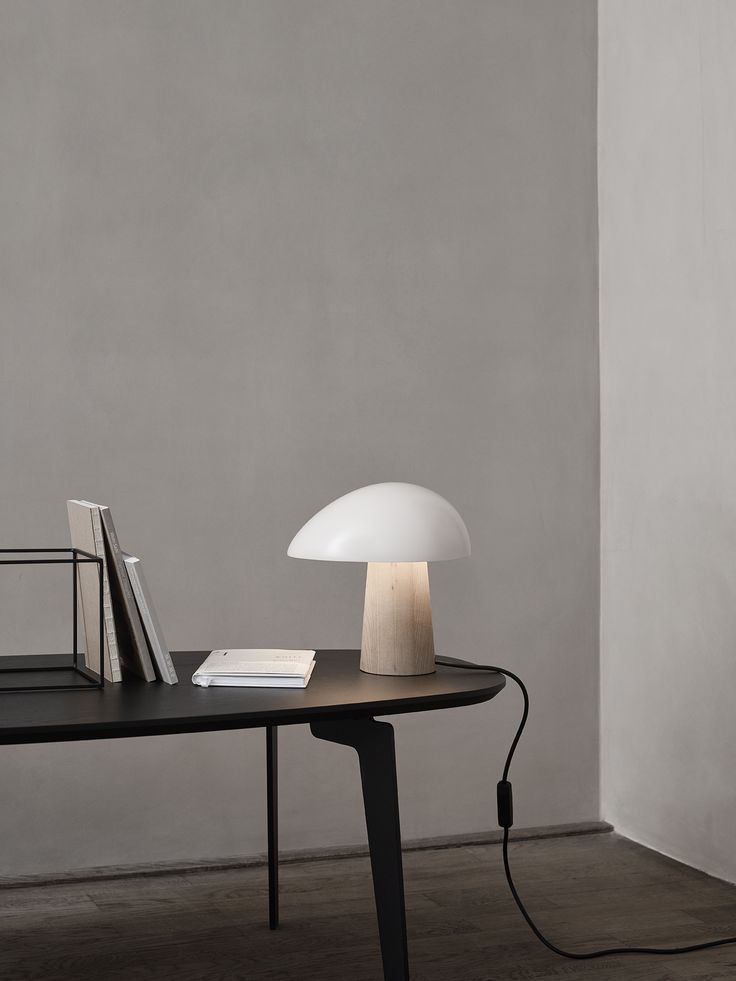 Nicholai Wiig Hansen's inspiration for designing the Night Owl™ table lamp was the desire to create a Nordic warm and cosy wash of light. The design is effortless and expresses that this is an informal table lamp. The shade can be placed in four different positions, allowing the black cable to exit the lamp in the desired direction. Night Owl™ is suitable for standing on e.g. a sideboard, shelf, bedside table or in a window. More info on www.lightyears.dk