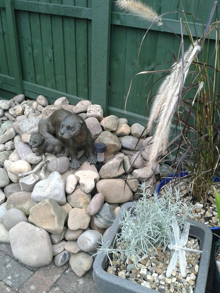Otters and large pebble stone rockery