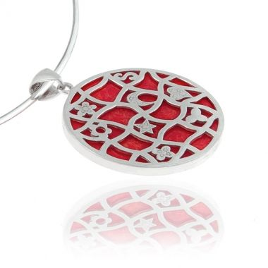 This sterling silver pendant features a round shaped red coral gemstone set in a distinctive design that will definitely catch everyone's attention. This pendant is reversible to show the red coral stone only. You can wear it all day creating varying and eye-catching looks. Show only the plain red coral stone during the day for your daily casual outings. If you need to go somewhere special in the evening just reverse it to show the unique sterling silver design.