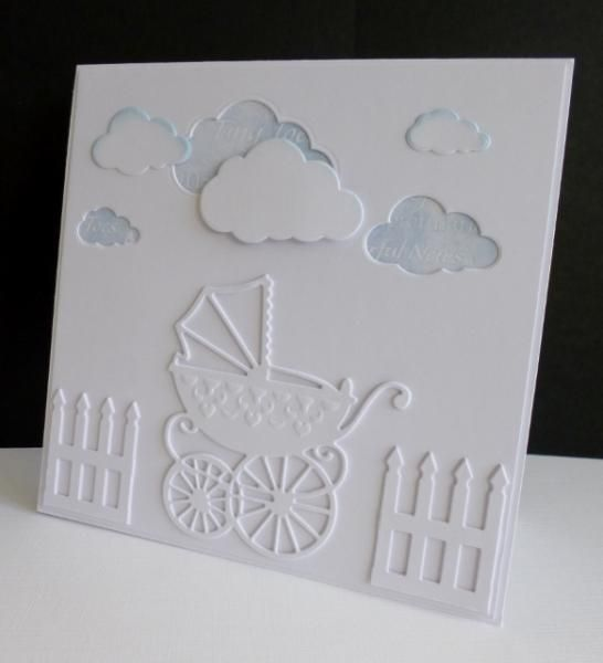 Wow - almost all white with touches of blue for a handmade baby card.  All white die cuts, including a stroller and fence, leading to pale blue pattern paper behind the clouds with a touch of powder blue edging.