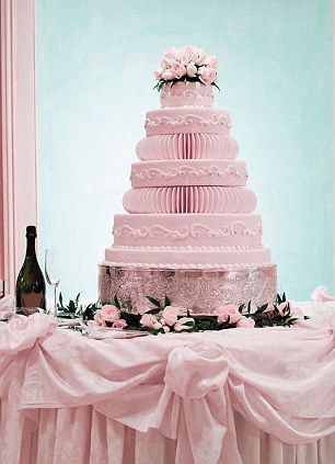 Feast: The wedding cake must look good as well as taste good - and there must be plenty of it as there are often food fights at the weddings...