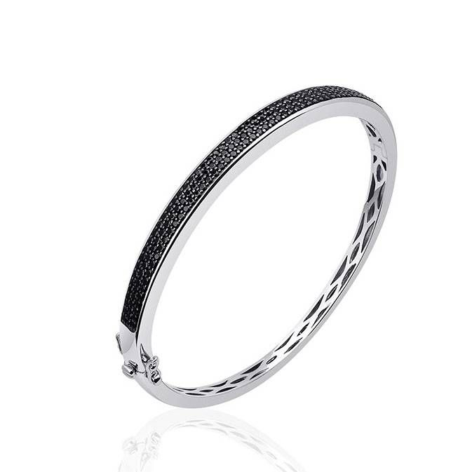 Very beautiful .925 Sterling silver bangle, rhodium coated and on top set with 3 rows of black zirconia's. - Goldberg Juweliers http://www.goldbergjuweliers.nl/en/silver-bangle-rhodium-coated-with-black-zirconias.html