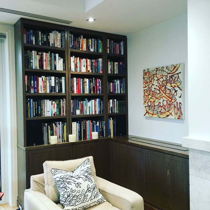 Timber veneer bookcase with solid timber bench tops.