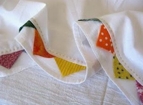 Prairie Points on dishtowels - inserted in a tuck near the hem, and decorated with running stitch embroidery above. So charming. http://www.accuquilt.com/shop/ssearch?q=square+dies