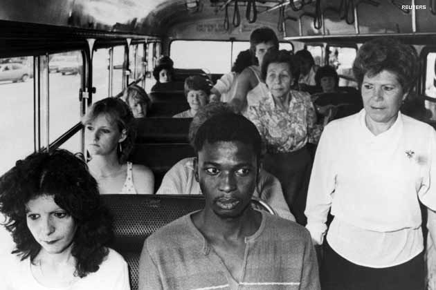 A black man rides a bus restricted to whites only in Durban in an act of resistance to South Africa's apartheid policies - 1986.