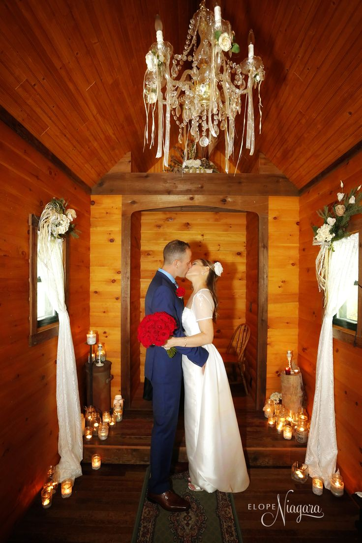 Kiss me here under the chandelier at The Little Log Wedding Chapel in Niagara with candle light