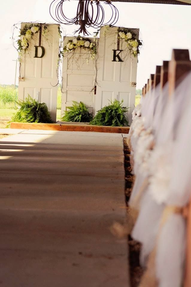 Vintage doors from the bride's great grandparents home, circa 1856, made a beautiful alter for this rustic, chic wedding!