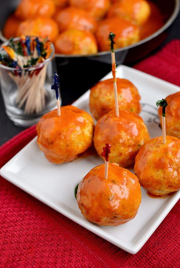 BOOM!!! Feta-Stuffed Buffalo Chicken Meatballs #tailgating #wings #appetizer  I would sub blue cheese for the feta to make it more like boneless chicken meatballs!