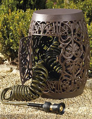 The decorative Coiled Hose Garden Storage beckons you to pause and sit awhile in the garden, yet it also stores our quality-crafted 75 ft. hose.