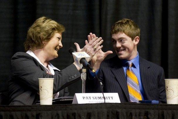 Pat Summitt and her son Tyler Summitt clasp hands during a press conference at Thompson-Boling Arena on Thursday, April 19, 2012.     (SAUL YOUNG/NEWS SENTINEL)