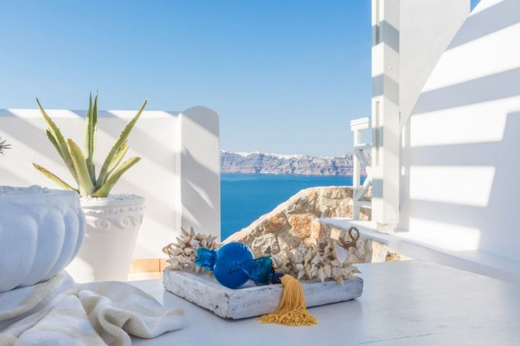 At Akrotiri, in a beautiful spot with amazing views of the volcano and the caldera, is situated one of the most beautiful Villas of the island, Villa Callidora. Colorful paintings, art objects, elegant furnishing and stunning views, all in harmony, give to Callidora a very warm and playful character.