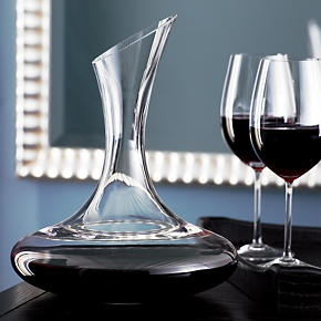 Sensuous curves and an angle-cut rim stand out at the table, buffet or bar. Handmade carafe allows wines to breathe and pours like a dream.