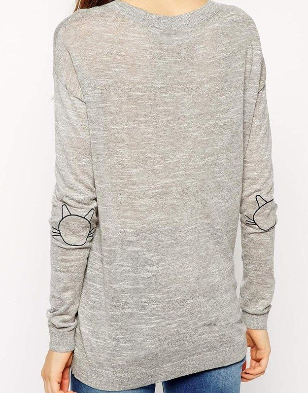 This sweatshirt with cute cat face elbow patches. | 23 Ways To Subtly Tell The World You're A Cat Lady