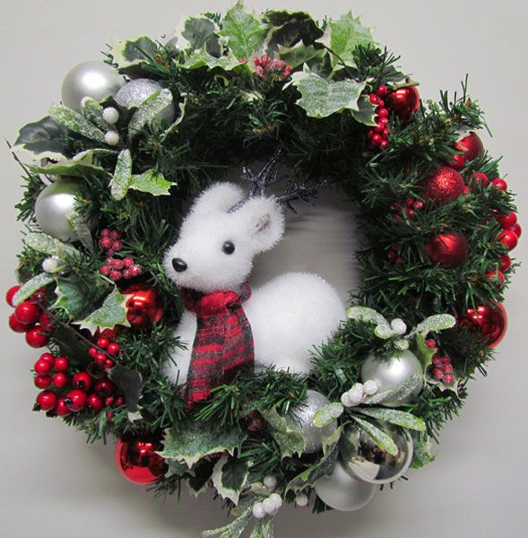 This snowy reindeer looks so cute, framed in a wintry wreath. By Miss Haberdash Christmas.