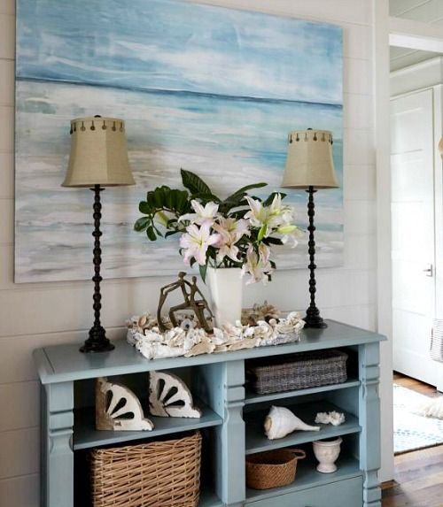 coastal beach house in pastel blue sandy beige http