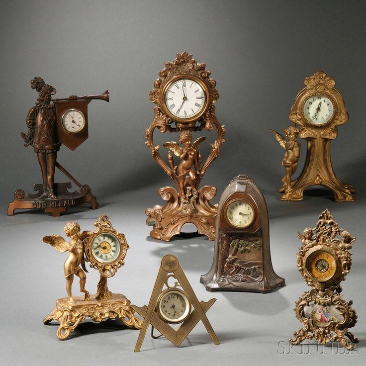 Seven Cast Metal Novelty Clocks | Sale Number 2708T, Lot Number 213 | Skinner Auctioneers