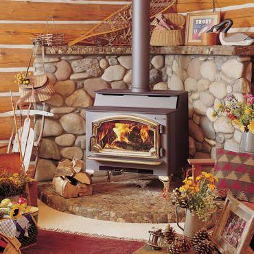 wood stove - stone hearth & mantel (other ideas: http://www.gokitchenideas.com/installing-wood-stove-stone-wall/installing-wood-stove-stone-wall-2/, http://www.countreeliving.com/Naturewoods-cedar-mantel.jpg)