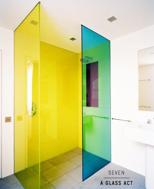 Use colored glass for your shower to create a bold pop of color. Be sure to consider the glass transparency and how it mixes the color (i.e. the photo shows only blue and yellow glass, but green is created where the colors overlap).