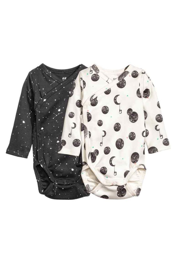2-pack wrapover bodysuits: CONSCIOUS. Wrapover bodysuits in soft organic cotton jersey with long sleeves and press-studs at one side and at the crotch.