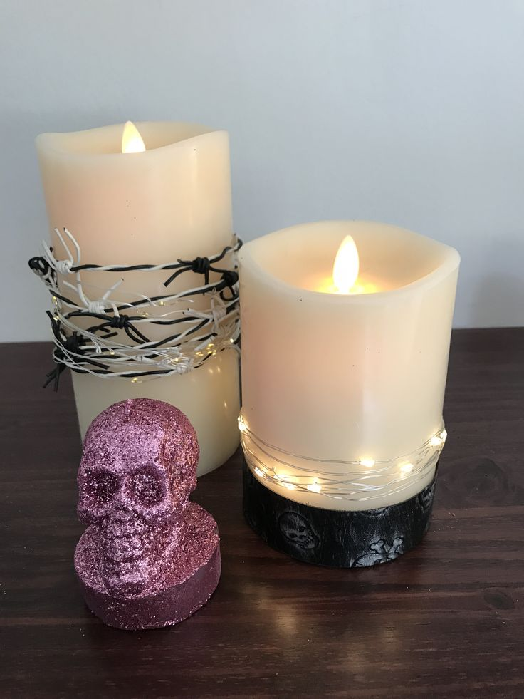 LED flameless, flickering wax candles embellished for a Rock 'n Roll party...a fun night to remember