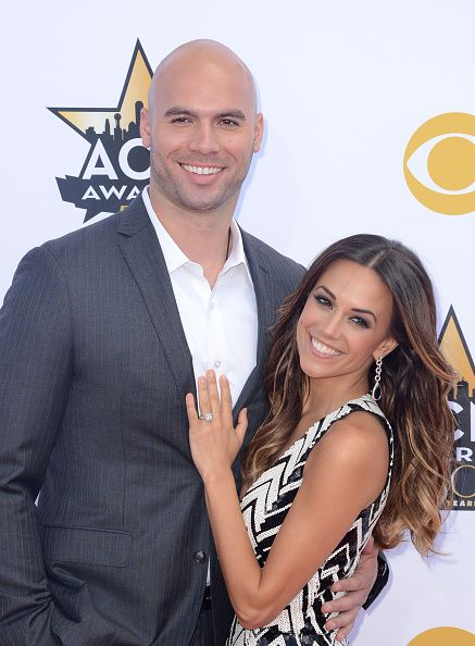 News Photo : Professional football player Mike Caussin and...