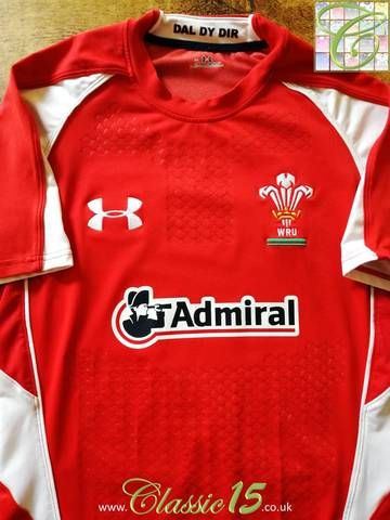 Official Under Armour Wales home pro-fit rugby shirt from the 2010/2011 season. Complete with textured grip assist on the body and sleeves.