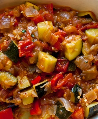 Ratatouille: Ingredients    2 tbsp Oil .  1 Small Onion diced  1Garlic clove diced  1 Eggplant small diced.  1 Zucchini Peeled & Diced.  2 Tomatoes Large & firm.  1 Green Bell Peppers Diced.  Salt  1 tsp Ground Cumin Powder  1 tsp Ground Coriander powder  1 tsp Chilli powder  ½ tsp Sugar (optional)