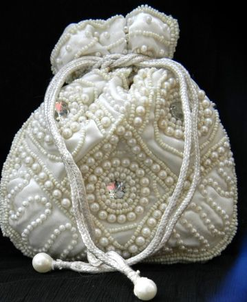 Go for sheer elegance with this stunning white beadwork drawstring pouch. Dimensions: Height: 6 in; Width: 4.5 in. Strap length: 15 in. - See more at: http://giftpiper.com/Handmade-Beadwork-Pouch-Batwa-White-id-261775.html#sthash.RBxOEB38.dpuf