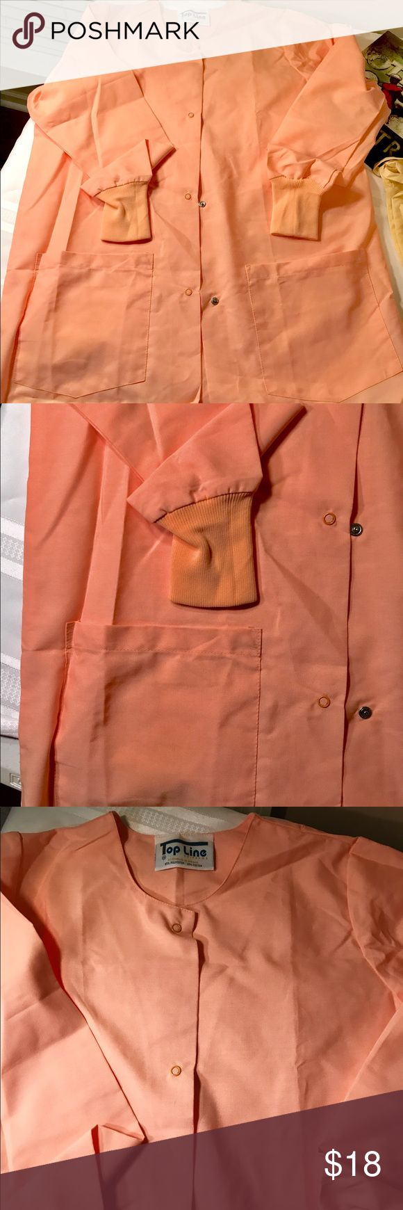 Corral scrub jacket 👩🏻🔬✴️ ( S) Get noticed in this super light weight Corall scrub cover jacket👩🏻🔬✴️. Measures: 29 inches shoulder to hem. 21 inches across front & 22 inches across the back. Super soft cuffs. This jacket goes with whatever color you choose. Choose to be uniquely beautiful, choose to be you. 👑🐝❤️ Tops