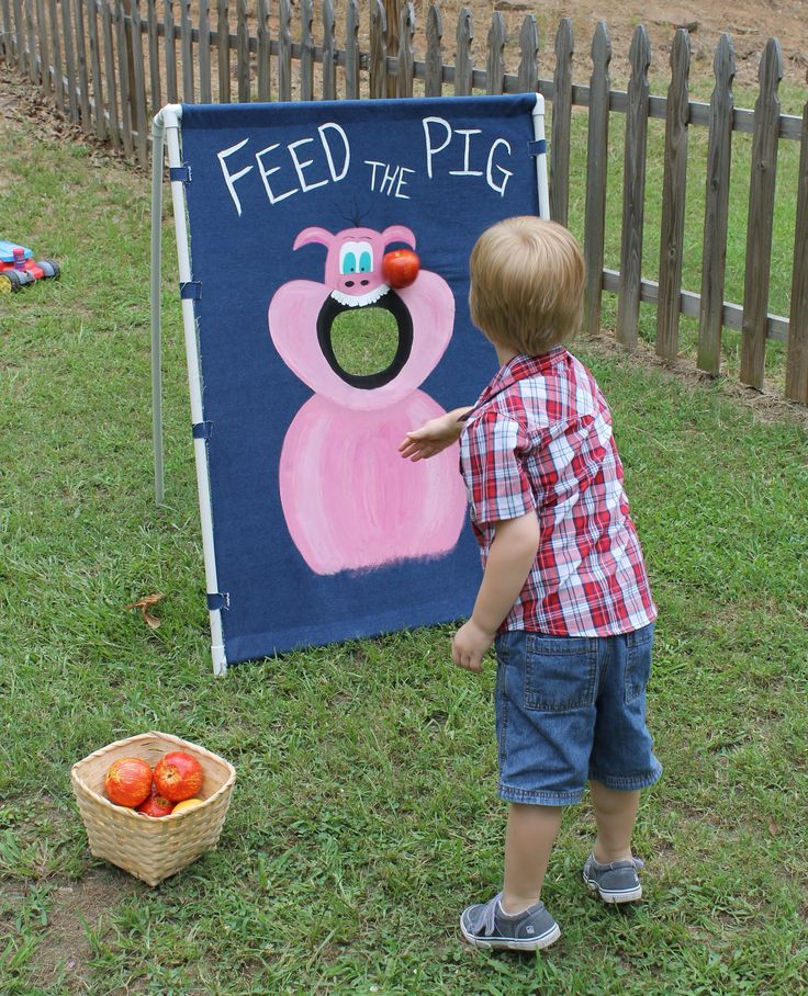 Farm party: Feed The Pig game made from pvc pipe and denim.  Add a basket of $ store fruit and have fun
