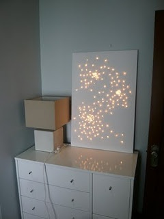 I would love to try this for my bedroom...how romantic! A starry canvas: twinkle lights punched through a plain canvas...