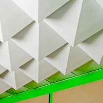 Suspended ceiling tile made by recycled materials