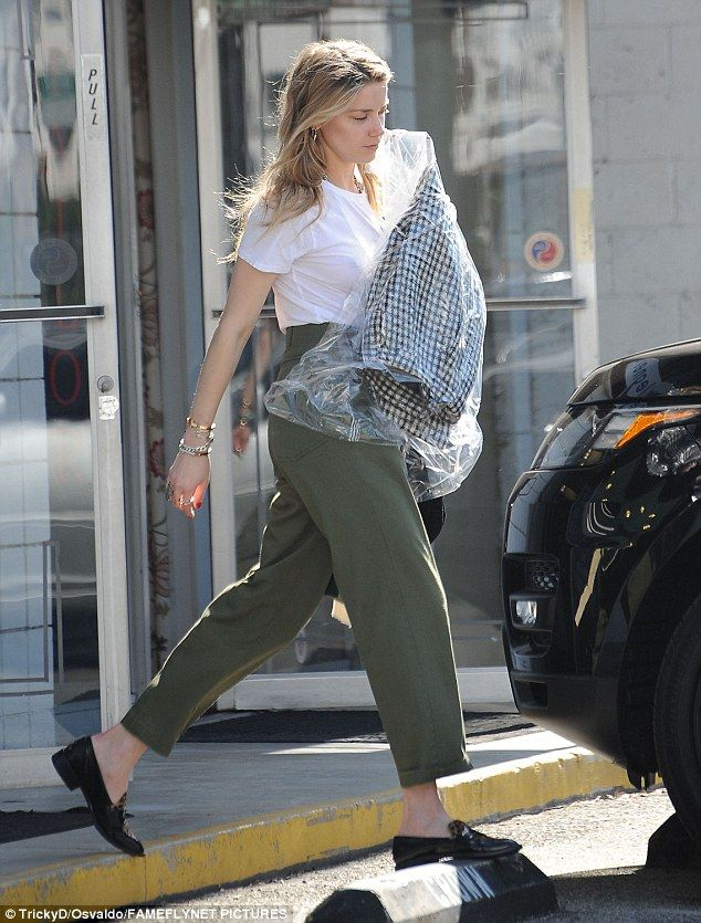 Casual: The young actress donned a pair of khaki trousers, a baggy white tee and a pair of loafers