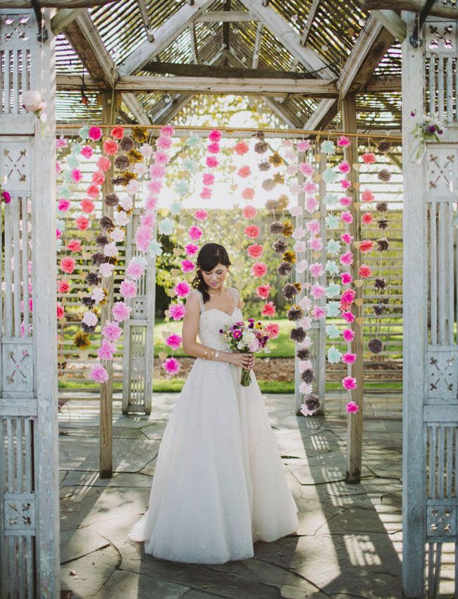 Romantic and colorful pom decor backdrop.
