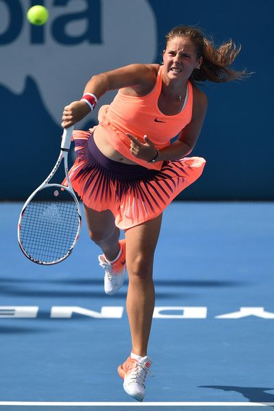 Daria Kasatkina of Russia hits a return against Johanna Konta of Britain during their women's singles quarter-final round match at the Sydney International tennis tournament in Sydney on January 11, 2017. / AFP / Peter PARKS / IMAGE RESTRICTED TO EDITORIAL USE - STRICTLY NO COMMERCIAL USE