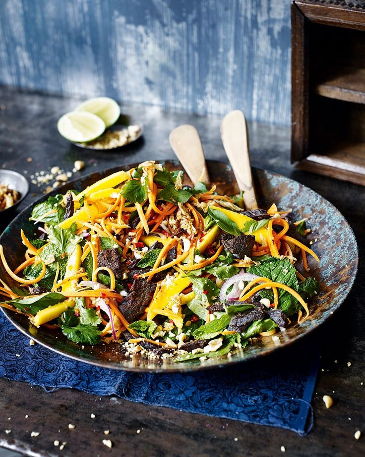 Transport yourself to Vietnam with every bite of this spicy beef salad. The sweetness from the mango and the crunch from the carrots help combat the heat from the marinade.
