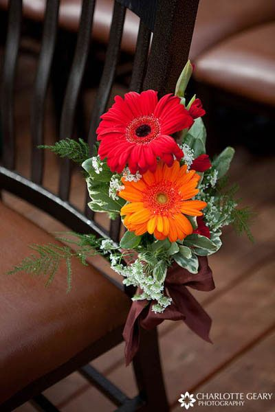 47 best gebera daisy wedding images on pinterest wedding bouquets orange and red gerbera daisies fastened to ceremony chairs junglespirit Gallery