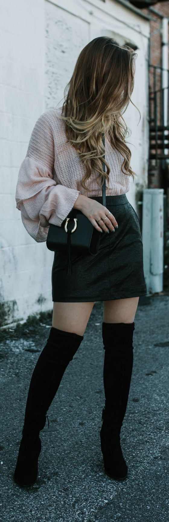 Cute weekend winter outfit styled with blush ruffled sleeve sweater, leather mini skirt, and black over the knee boots