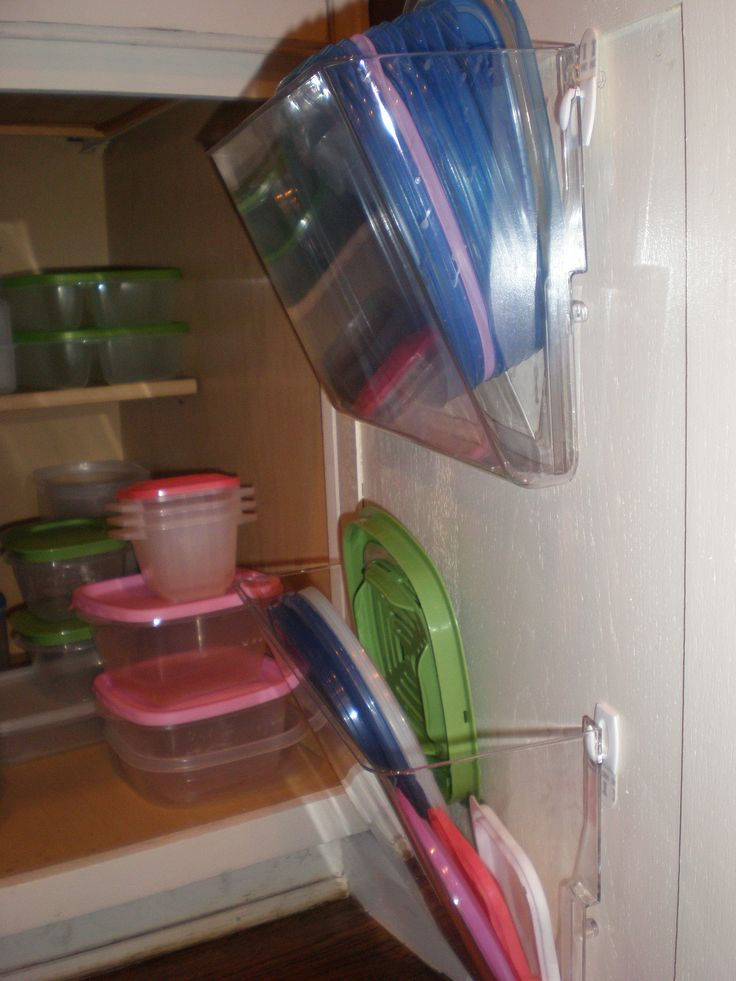 File holders on the inside of cabinet with command hooks for lid storage.