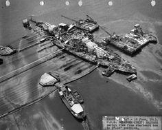 Salvage operations for the USS Oklahoma BB-37 after the ship was upright.  The Oklahoma was on it's way back to San Francisco for scrapping when it sunk under tow.  Today it sits on the floor of the Pacific somewhere between Pearl Harbor and California