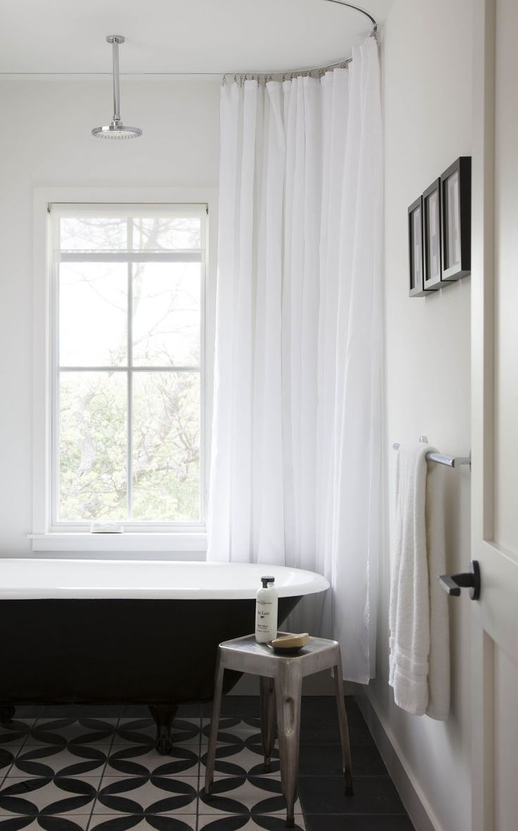 Guest bathroom with black and white tiles