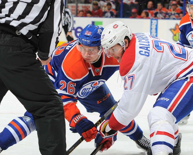 10.29.15 - Habs vs Oilers - Iiro Pakarinen #26 of the Edmonton Oilers lines up for a face off against Alex Galchenyuk #27 of the Montreal Canadiens at Rexall Place in Edmonton, Alberta, Canada. (Photo by Andy Devlin/NHLI via Getty Images)