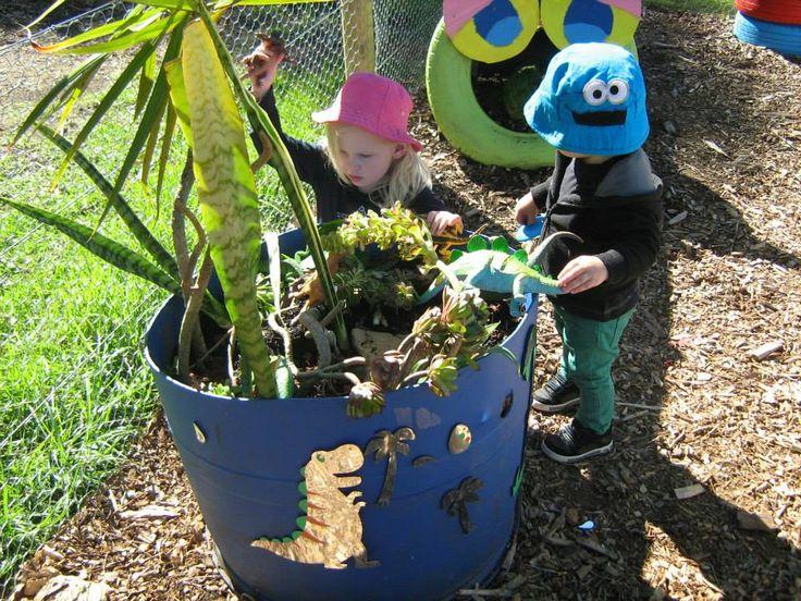 Playing in the  dinosaur garden