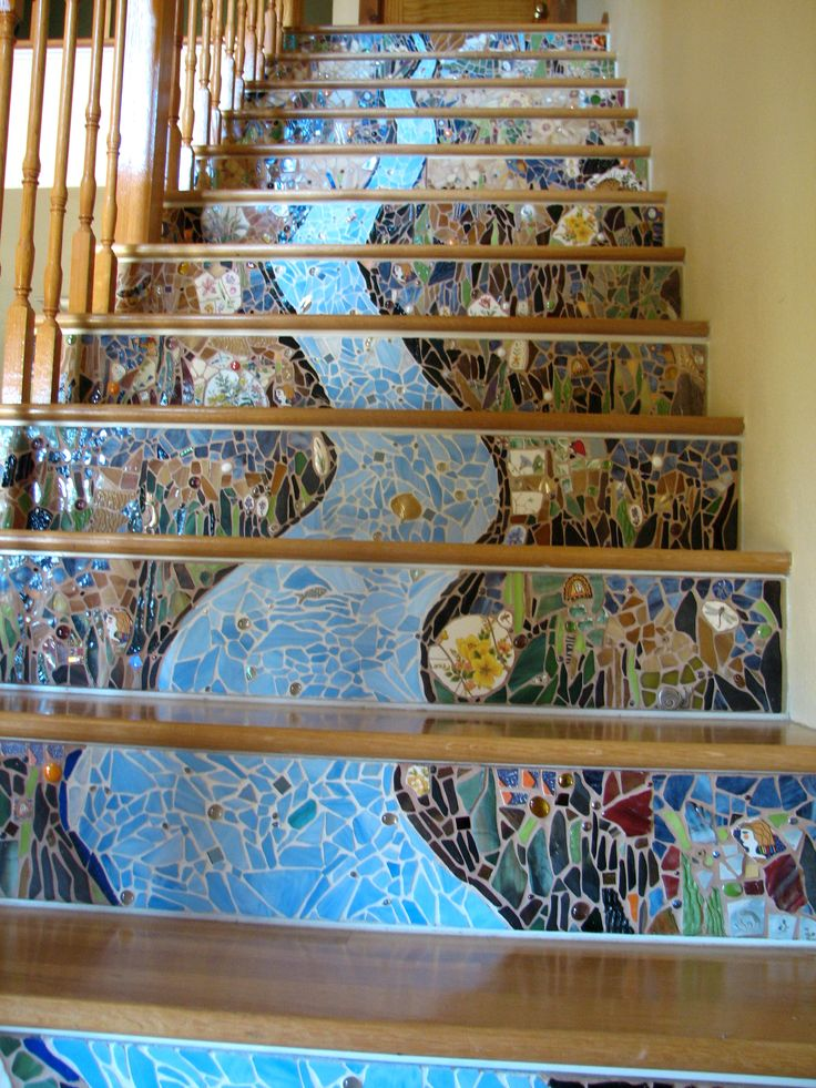 Easier to paint, in my opinion, but would be gorgeous with plexiglass.  How to mosaic stair risers using plexiglass. This is a truly inspiring DIY project! from: http://silvahayes.hubpages.com.  Also a good method for a kitchen backsplash.