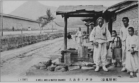 """A Well and a Water Drawer"", circa 1910"