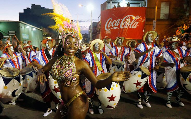 Members of a comparsa, a Uruguayan carnival group, dance during the Llamadas parade in Montevideo. Thousands of people crowd the capital's Barrio Sur as costumed drummers and dancers kicked off the street fiesta, which has traditional Afro-Uruguayan roots. Picture: Reuters