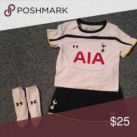 Spurs kit baby under armour Football (soccer to us) kit. Excellent condition. Under Armour worn twice. Too cute with those socks. Tottenham Spurs. 12-18 months listed on the label, but our very tall boy wore it when he was about 23 months and it looked perfect. Under Armour Matching Sets