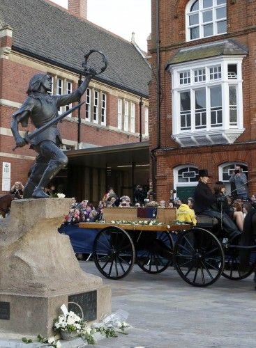 King Richard III passing by a statue of himself in Leicester.                                                                                                                                                      More