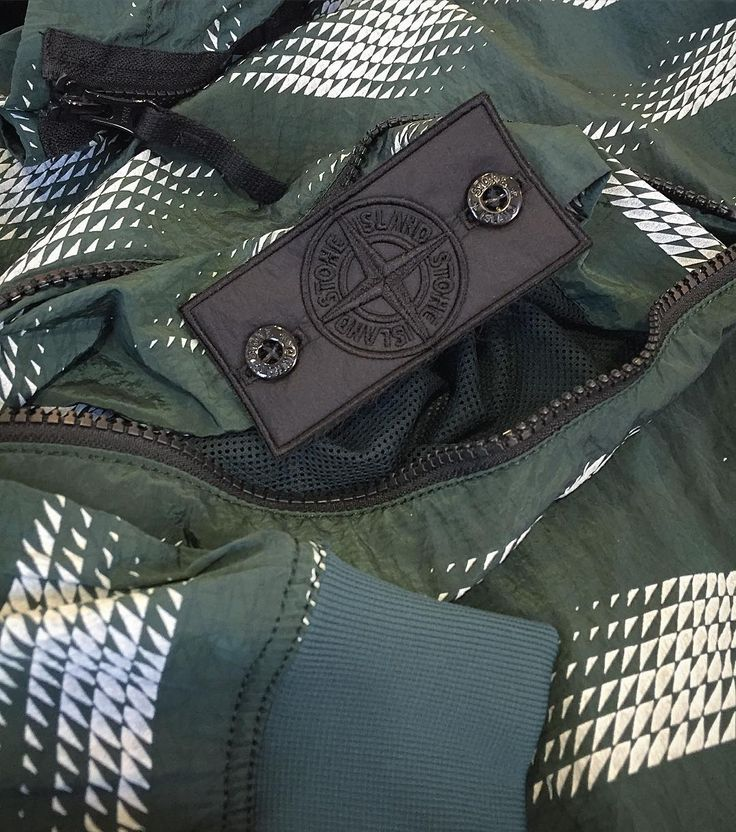 Stone Island Shadow Project SS16: n store and online. Shown here is the Nylon Metal printed pop-over anorak in green. The Nylon Metal fabric is one of Stone Island's most technical fabrics with a metallic iridescent appearance and a water resistant coating. #stoneisland #stoneislandshadowproject #shadowproject #blackbadge #nylonmetal #technical #outerwear #jackets #anorak #menswear #mensfashion #mensstyle #casuals #philipbrownemenswear